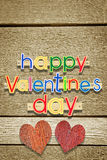 Two nailed wooden hearts and greeting text Happy Valentines Day Royalty Free Stock Images