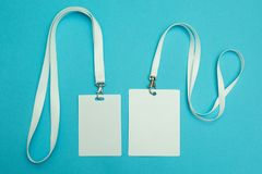 Two name tags on a blue background. Space for text and design stock photos