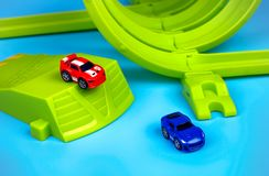 Two Nano Speed Micro Cars with Triple Loop Stunt Set on blue bac Stock Images