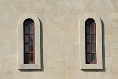 Two narrow arched windows in the old style Royalty Free Stock Image