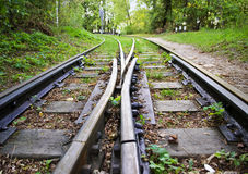 The two narrow-gauge railway tracks, divergent tracks Stock Images