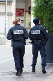 Two national policeman and police woman patrolling in the pedestrian street. Mulhouse - France - 9 December 2018 - Two national policeman and police woman royalty free stock image