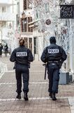 Two national policeman and police woman patrolling in the pedestrian street. Mulhouse - France - 9 December 2018 - Two national policeman and police woman royalty free stock photography