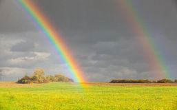 Free Two Natural Rainbow Over Green Field After Rain Royalty Free Stock Photo - 85958145