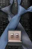 Two necktie and  cufflinks  lying on the skin Royalty Free Stock Photography