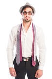 Two neckties hanging on male model wearing glasses and hat Royalty Free Stock Images