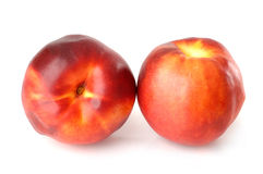 Two nectarine peaches. Two red nectarine peaches isolated on white background Stock Photo