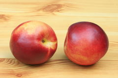 Two nectarines Stock Images