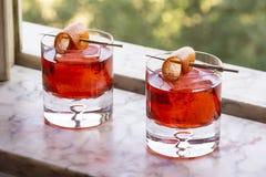 Two Negroni Cocktails Drinks with Orange Twist stock photos