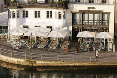 Two neighboring cafes by the River Reuss Royalty Free Stock Photo