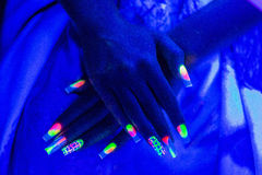 Two neon hands with long nails Stock Photo
