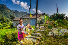 Two nepalese girls play in the garden of their home Royalty Free Stock Images