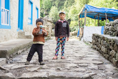 Two Nepali kids. In the mountains of Nepal stock photo