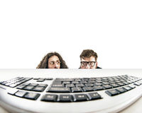 Two nerds staring at a keyboard Stock Photography