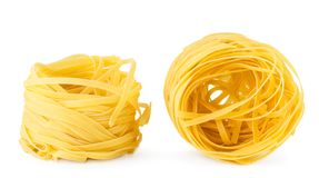 Two nests of pasta close up on a white background. Isolated stock images