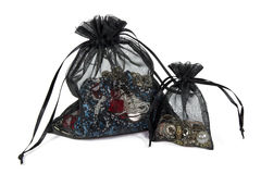 Two net pouches with jewelry. Two net pouches: one with gold and siver jewelry, another with red, black and blue beads Stock Photo