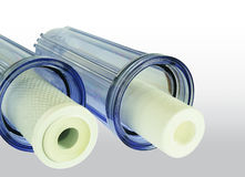 Two new household water filter cartridge & Jugs Stock Photos