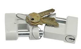 Two new padlocks. Two New close metal padlocks with keys isolated on white background Stock Images