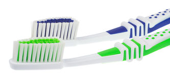 Two new toothbrushes Stock Photos