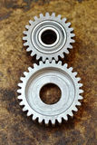 Two new toothed meshed gears Royalty Free Stock Photography