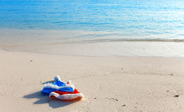 Two New Year s caps of Santa Claus on beach. Two New Year's caps of Santa Claus on beach royalty free stock photos