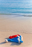 Two New Year s caps of Santa Claus on beach. Two New Year's caps of Santa Claus on beach.Landscape in a sunny day stock photos