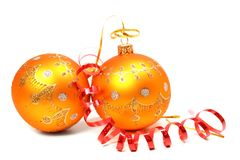 Two New Year's spheres of orange color and red tinsel. Two New Year's spheres of orange color and red celebratory tinsel Royalty Free Stock Photo