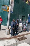Two New York City police officers talking at a Manhattan street corner royalty free stock image