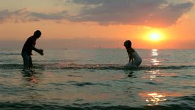 Two Newlyweds Splashed Into The Sea. Knee-deep in water stock video footage