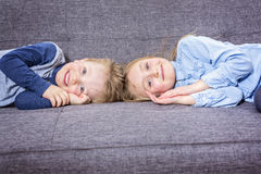 Two nice child boy and girl on sofa Stock Images