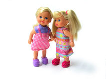 Two nice dolls. Teen girls in beautiful dresses on a white background royalty free stock photography