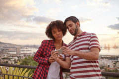 Two nice friends looking at a cellphone Royalty Free Stock Images