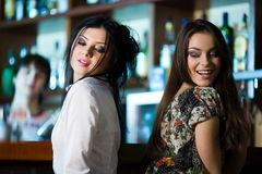 Two nice girls in bar Royalty Free Stock Images