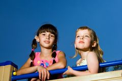 Two nice girls on blue background Royalty Free Stock Photos