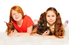Two nice girls happy with dogs on the floor Stock Photography