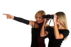 Two nice girls watching something with a binocular Stock Photos