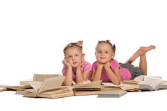 Two Nice Little Girl Lying On Pile Of Books Royalty Free Stock Photo