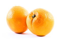 Two nicely colored oranges on a white background - front and back next to each other.  Royalty Free Stock Image