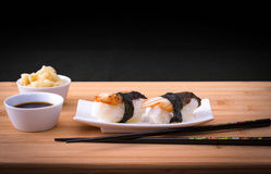 Two nigiri sushi eel with soy sauce on bamboo table Royalty Free Stock Photography