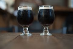 Two nitro cold brew coffees in glasses Stock Photography