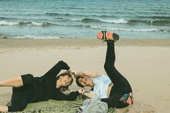 Two women having fun on the beach royalty free stock photography