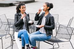 Best friends drinking coffee in city Royalty Free Stock Photo