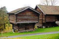 Two norwegian wooden farm barn for hay Stock Photography