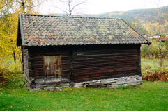 Two norwegian wooden farm house for animals. Norwegian wooden farm buidlings from 18. century. View of the Heddal bygdetun, is a Heddal Open Air Museum with Royalty Free Stock Images
