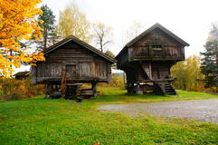 Two norwegian wooden farm house for food Stock Photos