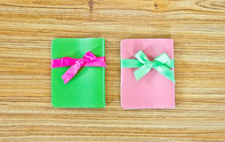 Two notebook gifts on wooden table Royalty Free Stock Image