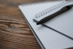 Two notebook with pen on old wooden table. Small depth of field Stock Photo
