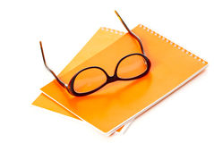 Notebook and glasses Stock Images