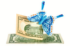 Two notes of American dollars with butterfly. Royalty Free Stock Photo