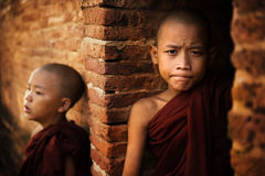 Two Novice monk. Two young buddhist novice monk outside a temple background royalty free stock images